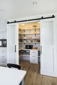 Pantry ideas with sliding barn #doors and #rustic decor