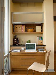 Hidden office space, drawer opens for laptop desk.