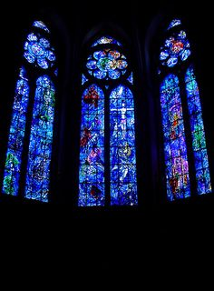 Marc Chagall Windows at the Cathedral of Notre Dame, Reims, France.  You have to sit in the nave to see how Chagall made his modern window fit in with the much older ones that surround it.  It doesn't look out of place.  There are simple things, like the crucifix being in the same place as that of another window nearby.  He worked without rebellion against what was beautiful and old.