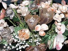 seashell bouquet #flowers #seashells Lady does beautiful bouquets, hair clips, stems of what appear to be mostly southeastern US shells. Website has other art, gardening, and useful information.