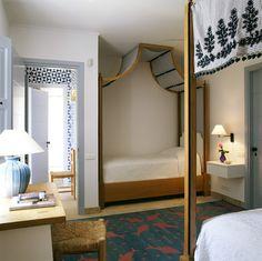 John Stefanidis ~ A durrie rug for a guest bedroom on a Greek island