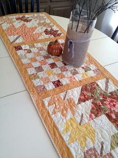 Autumn decor:  Fall table runner made with maple leaf blocks and Fig Tree & Co. fabrics