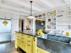 marble-vs-granite-for-a-shabby-chic-style-kitchen-with-a-black-countertop-and-eclectic-kitchen-by-j-a-s-design-build.jpg 990×742 pixels