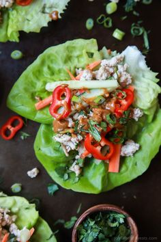 Thai Chicken Lettuce Wraps - made from scratch with chicken fresh ginger cilantro fresh vegetables and slathered with a Spicy Peanut Sauce. This quick easy recipe is ready in just 20 minutes and to die for! Quick Easy Dinner, Quick Dinner Recipes, Easy Healthy Dinners, Easy Healthy Recipes, Quick Easy Meals, Healthy Eats, Keto Recipes, Thai Chicken Lettuce Wraps, Easy Lettuce Wraps