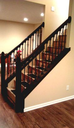 modern expresso stair railing with iron spindles grey walls - Google ...