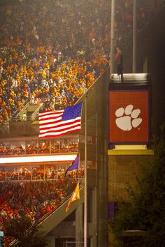 https://flic.kr/p/z9BN4v | Memorial Stadium American flag | The American Flag flies in the wind during a rain storm at Clemson University's Memorial Stadium as 83,000 drenched fans cheer on their team from the bleachers, Oct. 3, 2015. The Clemson Tigers were playing Notre Dame, and won 24-22. (Photo by Ken Scar)