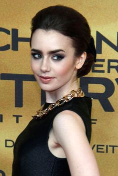 Think bows are too cutesy for Homecoming? Think again! >> Perched atop an elegant chignon, Lily Collins' ladylike accessory is unexpectedly cool