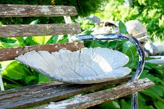 Make your own birdbath/flower pot with just cement and sand.