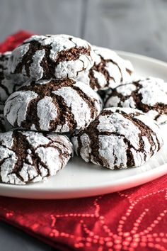Classic Chocolate Crinkle Cookies! Chocolate cookies rolled in powdered sugar and baked to light & crumbly perfection. They're the perfect combination of a brownie and a cookie! | HomemadeHooplah.com