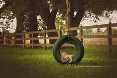 Elijah Layne's #newbornphotography in a tire swing! #outdoorsybaby #trueexpressionsphotography #tomballtx