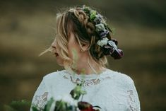 Braid crown topped off with a moody floral crown is the perfect casual and pretty bridal hairstyle | Image by Maggie Grace Photography  #bridalportrait #bridalstyle #bridalfashion #bridalinspo #bridalinspiration #bride #bridalhair #bridalhairstyle #bridalmakeup