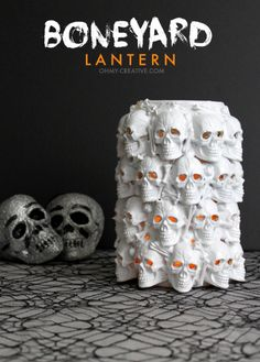 Boneyard Lantern - A Pottery Barn knock off created from plastic skull and bones. Glamorous and creepy all at the same time for Halloween!