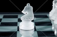 side view of a chess knight - Close-up side view of a chess Knight with a pawn on the back