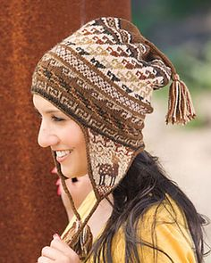 This cap is inspired by the Andean Chullo (pronounced tchoo-yo), a traditional garment knit and worn by Andean men, women, and children. Knit in Palette yarn, this hat is knit from the earflaps up, with applied i-cord and tassels to finish. This stranded colorwork hat features a band of alpacas set across a background of color gradients and geometric patterns inspired by motifs found in Andean artwork.