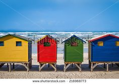 Row of brightly colored huts in Muizenberg beach. Muizenberg, Cape Town. South Africa - stock photo