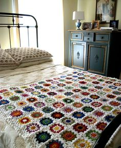 This handmade 'Granny Chic' crocheted blanket is bursting with cheery colors that will brighten up a room and add a touch of vintage inspiration to your decor. 44 by 50 inches. Yarns are a wool/ mohair blend. Granny Chic, Big Granny, Manta Crochet, Crochet Granny, Granny Square Afghan, Granny Squares, Flea Market Style, Handmade Home, Crochet Patterns
