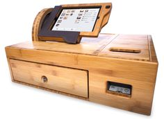 Bamboo iPad cashbox from The Happy Owl Studio. APG's cash drawer is included in this solution. Learn more about our Vasario 1416 cash drawer here: http://www.cashdrawer.com/products/vasario/1416-cash-drawer