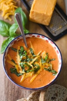 Tomato, Basil, and Cheddar Soup ( uses Greek yogurt instead of cream, brilliant) Makes 6 servings 2 28-oz. cans of diced tomatoes 1 yellow onion, chopped 2 cloves of garlic, chopped 1 tsp olive oil 2 cups of vegetable broth 1 cup of plain Greek yogurt 1 cup cheddar cheese, grated 1/2 cup basil, chopped, loosely packed 2 tsp of oregano 1 tsp sugar salt and pepper to taste Repinned by Sharon Greenwood onto Favorite Recipes