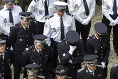A police officer breaks down as his colleagues pay homage toJean-Baptiste Salvaing and his wife Jessica Schneider, who were stabbed to death at their home in Magnanville. Yves Lefebvre, of the French police union, said: 'Today every police officer is a target'