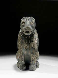 Stone (steatite and white limestone?) of a crouching feline. Front view. Near Eastern. 3rd millennium B.C.   Phoenix Ancient Art Gallery