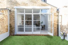 Lovely Victorian end of terrace house in Clapham Open plan living/dining area with fireplace and crittall windows . Decoracion Vintage Chic, Period Living, Rustic Patio, Garden Doors, Open Plan Living, Photo Location, Bay Window, New Homes, Architecture