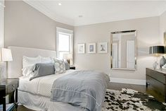 wall color: Benjamin Moore's Grege Avenue, bedding: Bloomingdales, mirror: Restoration Hardware.