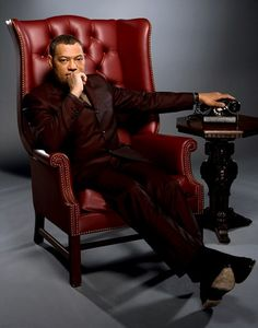 Laurence Fishburne in The Matrix Actors Return to their Most Iconic Roles for Empire's Gerard Butler, Empire, Lawrence Fishburne, Grand Film, Sarah Dunn, Cinema, Famous Movies, Person Sitting, Chef D Oeuvre