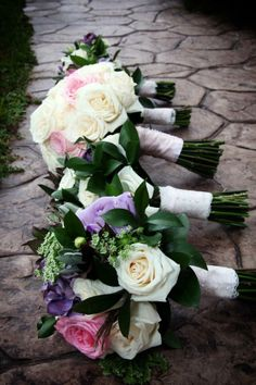 Bridal bouquet - cream roses with soft pink garden roses wrapped in soft pink satin ribbon and lace. Bridesmaid bouquet - vendela roses, soft pink garden rose, lavender roses, sage leaves, ruscus leaves, fall grass plumes, and queen anne's lace. Flowers by Allison Enzenbacher https://www.facebook.com/weddingflowersbyallison Photo by Abigail Rachel Photography https://www.facebook.com/pages/Abigail-Rachel-Photography/78827885020