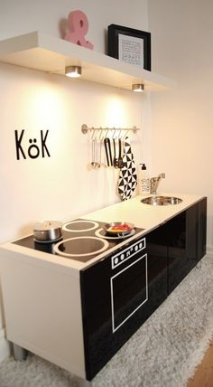 black and white modern play kitchen with upper lights try with a dresser? Kids Indoor Playhouse, Build A Playhouse, Diy Play Kitchen, Toy Kitchen, Ikea Duktig, Deco Kids, Ikea Kids, Kids Corner, Kid Spaces