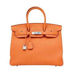 Coveted H Orange is quintessentially Hermes BIRKIN 35 and no longer produced. Fresh with palladium hardware. Togo leather has a scratch resistant texture and is butter soft to the touch. NEW or NEVER