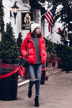 Red puffer jacket & black + white striped sweater