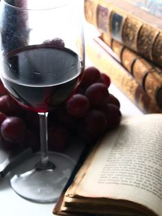 A glass of good red wine and an old book..does it get any better?