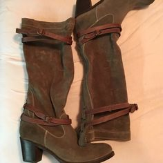"""Frye suede boots with leather straps Worn maybe 5 times. Great condition except the tiny scuff on one of the leather straps. Heel starts at 2"""" and rises up to 3"""". Has small frye symbol on side of heel. Color is a grayish brown. Goes with a lot. And those aren't stains, it's how the fabric photographed. Frye Shoes"""