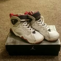 Olympic color Air Jordan 7 Retro  (GS) Air Jordan 7 Retro  (GS)  size 6y. In original box. Wore them a good amount but still in good condition. Jordan Shoes Sneakers
