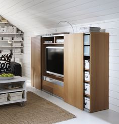 Short on space? The BESTÅ/INREDA combination has the option of sliding doors. Perfect for hiding the TV.
