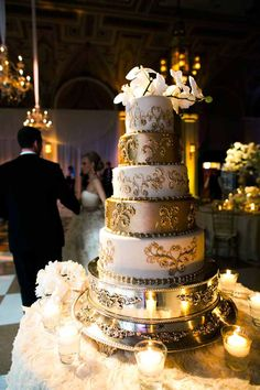 Love the gold and ivory tiered cake...so glam...even if you had a few faux layers...
