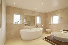 Lots of windows let lots of natural light into the bathroom, and the bath is sleek and sophisticated #Yorkshirepropertyoftheweek
