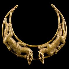 Scythian Gold Double Dragon Torc Necklace from Central Asia (200 BC -  Description: Circa 2nd century BCE - 1st century CE, Scythian Hundreds of tiny scales are individually soldered to the writhing forms of two confronted dragons on this magnificent gold torc. Thick curving horns sweep back over the long pointed ears of the rather wolf-like dragon heads.