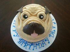 "Pug/dog face cake. Face is all fondant. Butter cream cake. White & chocolate cake with oreo frosting filling. This is a 9"" cake & the face was made on a 8"" cake board. Not shown is the dog collar at base of cake"