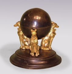 An unusual early 19th Century Regency period bronze and ormolu Inkwell, in the form of central sphere inkwell held by triple greyhound supports with engine turned collars, ending on circular moulded base. Circa: 1825 Ref: 5652