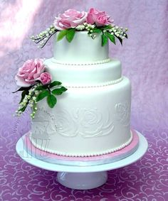 Roses and lily of the valley  By: pippilotta  URL: http://cakecentral.com/gallery/2263393/roses-and-lily-of-the-valley