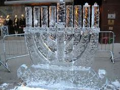 Chanukah menorah public art, carved out of ice.