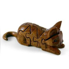 "Wood Cat Puzzle by The Mouse Factory. $29.95. 7.25""w x 2.75""t x 1.75""d.. Handmade wooden cat puzzle. 3-dimensional puzzle. Ages 5 and up. Non-toxic. This beautiful cat puzzle was hand carved by Gwen Handland of The Mouse Factory in Hillsboro, Oregon. The cat puzzled is carved from African Khaya wood from the Mahogany family of trees. For ages 5 and up. 7.25""w x 2.75""t x 1.75""d."