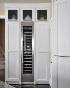 Wine cooler with cabinets on either side for storage...Love.