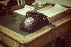 Old telephone on old fashioned office desk Please look here for more historical items: For more similar images: