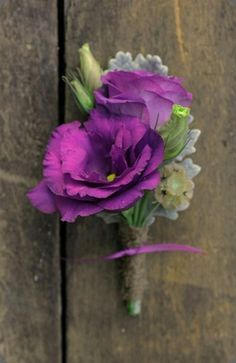 Groom's boutonniere to have one purple lisianthus, one purple rose and greenery.  Groomsmen boutonnieres to have lavender and purple lisianthus and greenery
