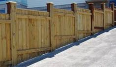 how to build a fence on a sloped yard