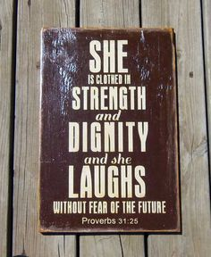 Typography Wood Sign -Proverbs 31:25 She Is Clothed in Strength and Dignity Wall Decor. $45.00, via Etsy.