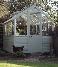 Little greenhouse - never in a million years would this fit in my back yard. But we can dream.