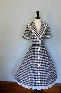 Cute gingham fifties dress. I love it. My favorite by far!!! Only in my signature color, yellow!!!!:)